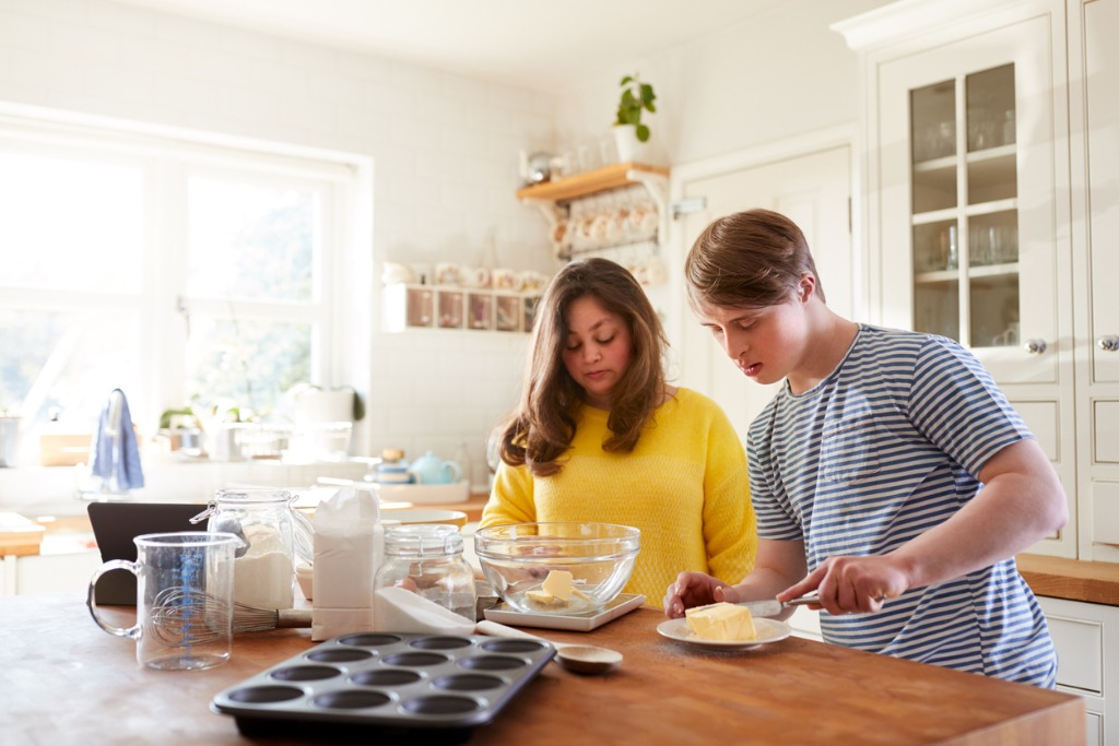 down syndrome couple following recipe on tablet